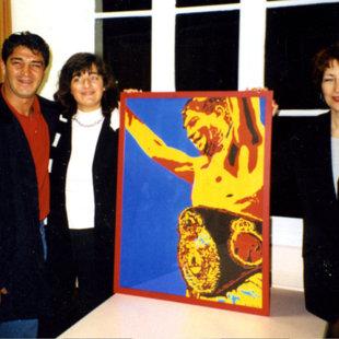 Avec  Laurant Boudouani (champion du monde de boxe 1996/1999) devant son prtrait